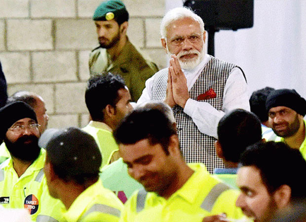 Prime Minister Modi shares meal with Indian workers in Qatar