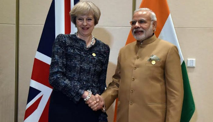 Need to eliminate safe heavens for economic offenders, Modi tells May