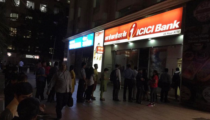 People lining up at ATMs for Rs 100 denomination notes