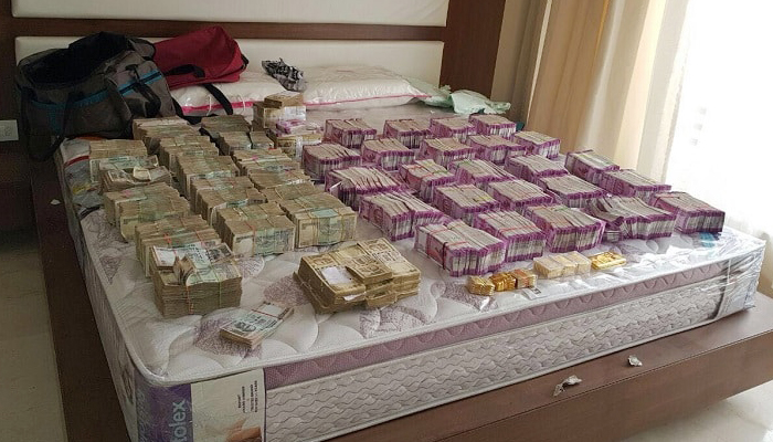 Rs 5.7 crore in new notes seized from bathroom of hawala operator