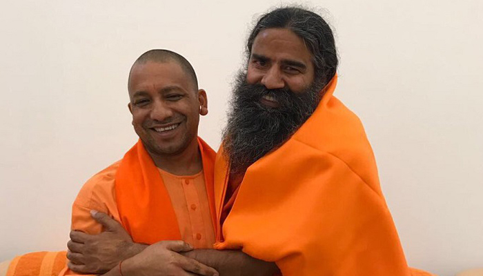 CM Yogi takes Yoga lessons from Ramdev in Lucknow