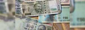 Rupee falls to fresh low of 71.37 per dollar