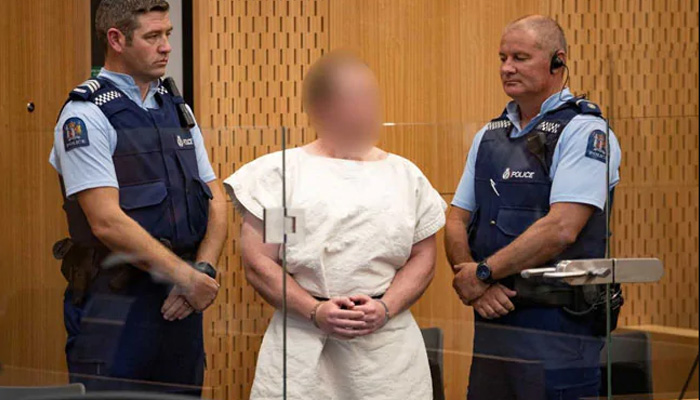 New Zealand terror attack accused smirks during court trail