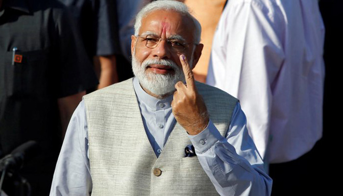 Voter ID more powerful than IED, says Modi after casting vote
