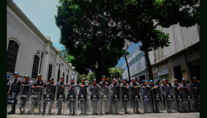 At least 29 inmates killed, 19 police wounded in clashes at Venezuela jail