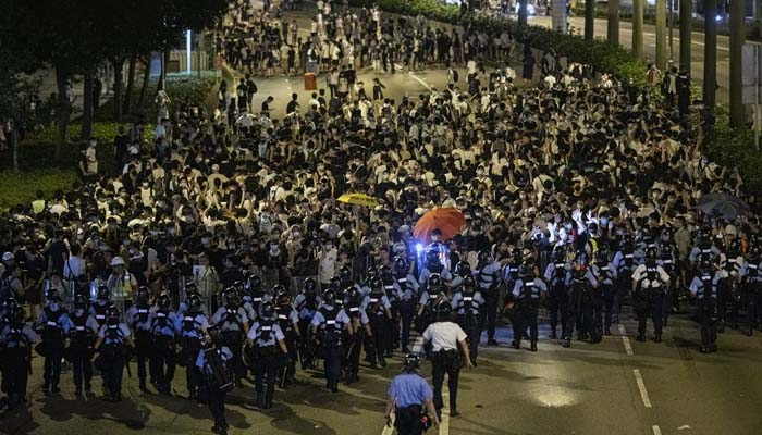 China hints at deployment of military to quell protests in Hong Kong