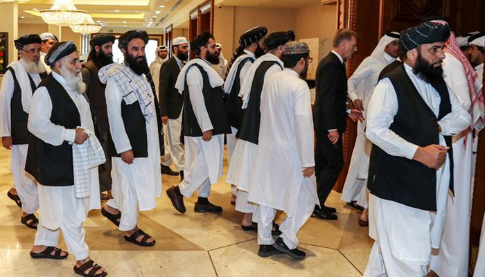 Dozens of powerful Afghans resume talks for peace with the Taliban