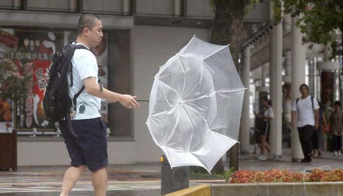 A powerful tropical storm lashes Japan, snarls holiday travel