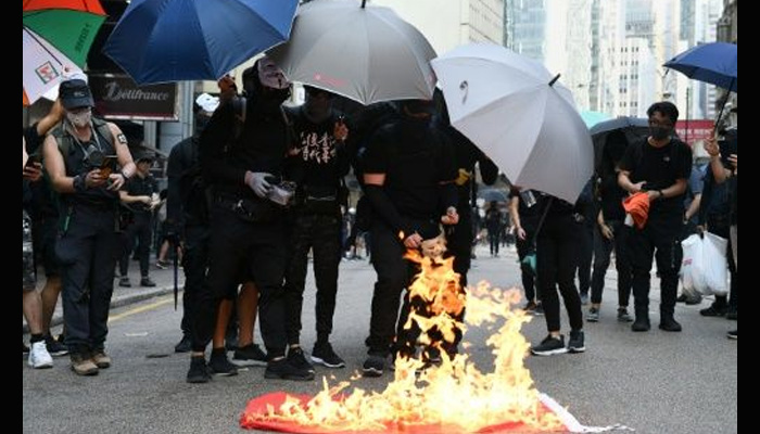 Hong Kong defies China anniversary with Day of Grief rallies and clashes