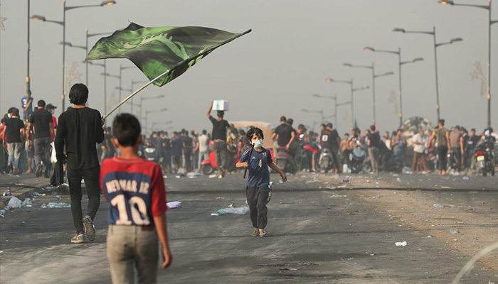 Iraqi protesters defy curfew as violence leaves 31 dead