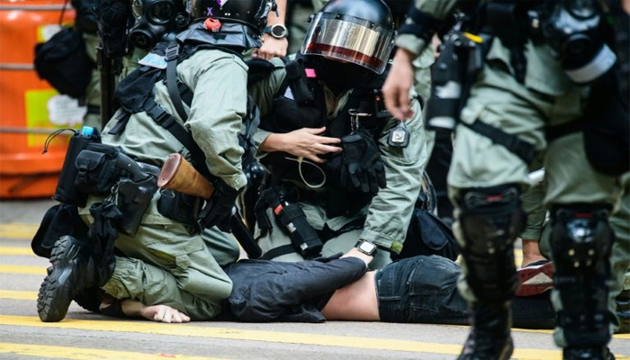Hong Kong officer hit by arrow as activists vow to squeeze economy
