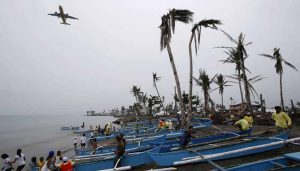 Peace wishes ring in Christmas, but typhoon dampens joy in Philippines