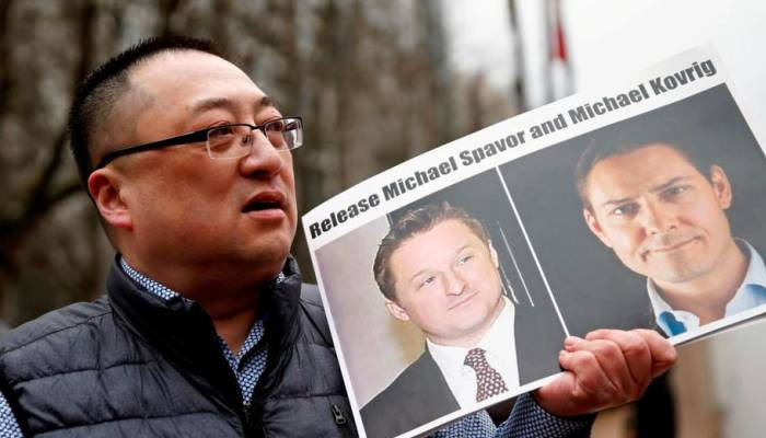 China says detained Canadians treated in civilised way