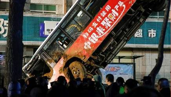 Huge sinkhole swallows bus; Kills six in China: State Media