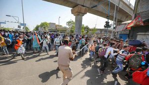 Migrants pelt stones at police, public in Ahmedabad