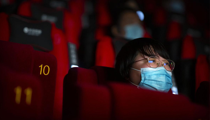 Beijing partly reopens movie theatres as virus declines