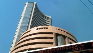 Sensex, Nifty end flat after see-saw trade; RIL hits fresh peak