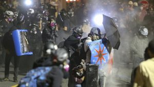 Portland clashes rage again outside US immigration building