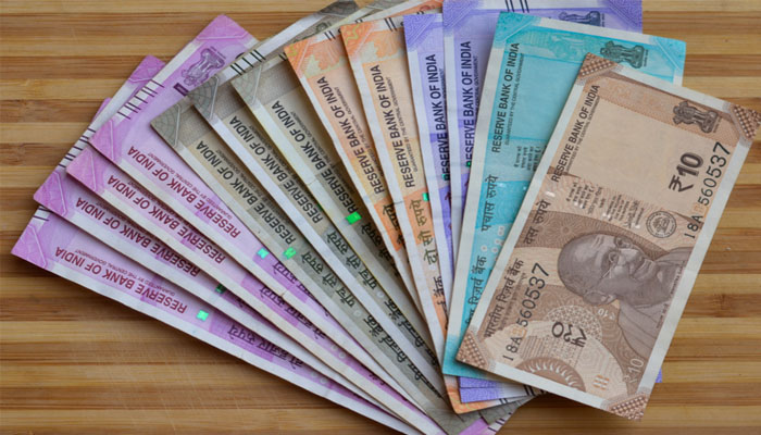 Rupee surges 11 paise to 74.77 against US dollar in early trade