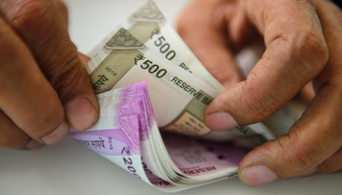 Rupee settles 12 paise higher at 74.78 against US dollar