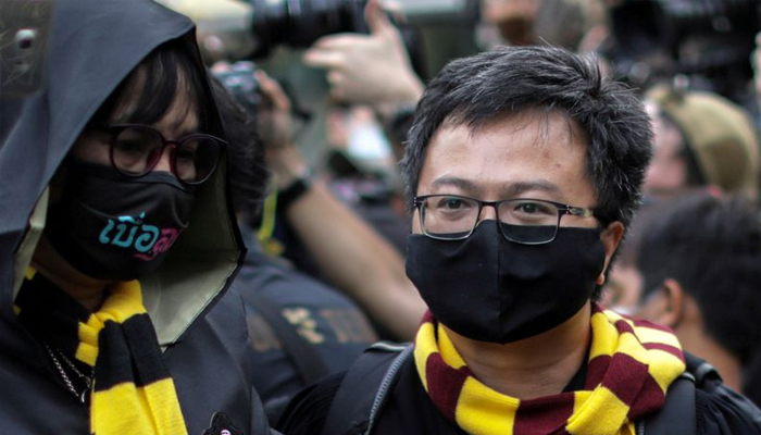Thai protesters threaten escalation as police make arrests
