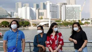 Singapore warns of further waves of COVID-19 until vaccine found