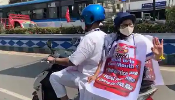 Mamata Banerjee takes e-scooter ride; Protests against Fuel Price Hike