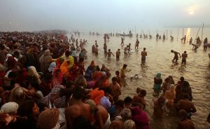 ALLAHABAD, INDIA - JANUARY 23: Hindu pilgrims gather to bathe at sunrise at the ritual bathing site at Sangam, the confluence of the Ganges, Yamuna and mythical Saraswati rivers during the Ardh Kumbh Mela festival (Half Pitcher festival) January 23, 2007 in Allahabad, India. Today is one of the major bathing days of the festival celebrating the first day of spring in North India. Tens of millions of Hindu pilgrims have already attended the 45 day festival in northern India which is the largest religious gathering in the world. The festival commemorates the mythical conflict between gods and demons over a pitcher filled with the 'nectar of immortality'. Devotees believe that taking a holy dip in the Ganges at this time washes away their sins and paves the path to salvation. (Photo by Mario Tama/Getty Images)