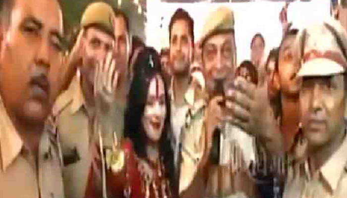 Radhe Maa seen dancing with Delhi Police cops; two suspended