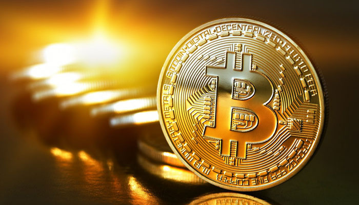 Bitcoin value hits record high, surpasses $10,000 mark for first time