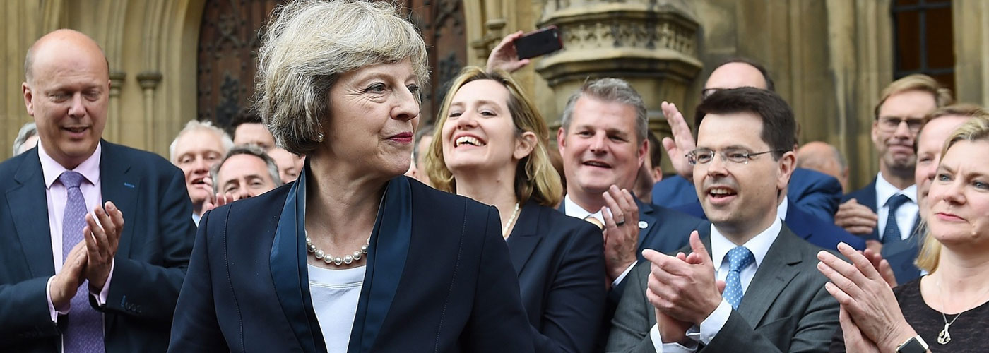 May wins vote for smooth Brexit despite facing rebel MPs