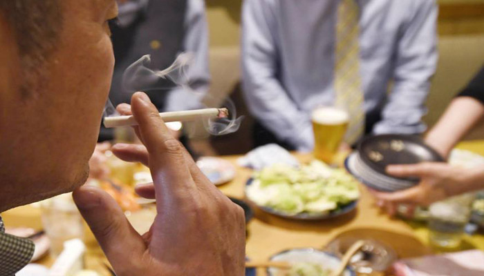 Japan approves watered-down anti-smoking law