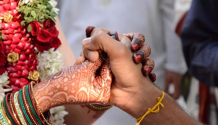 Amid grief, a wedding takes place in Kerala relief camp